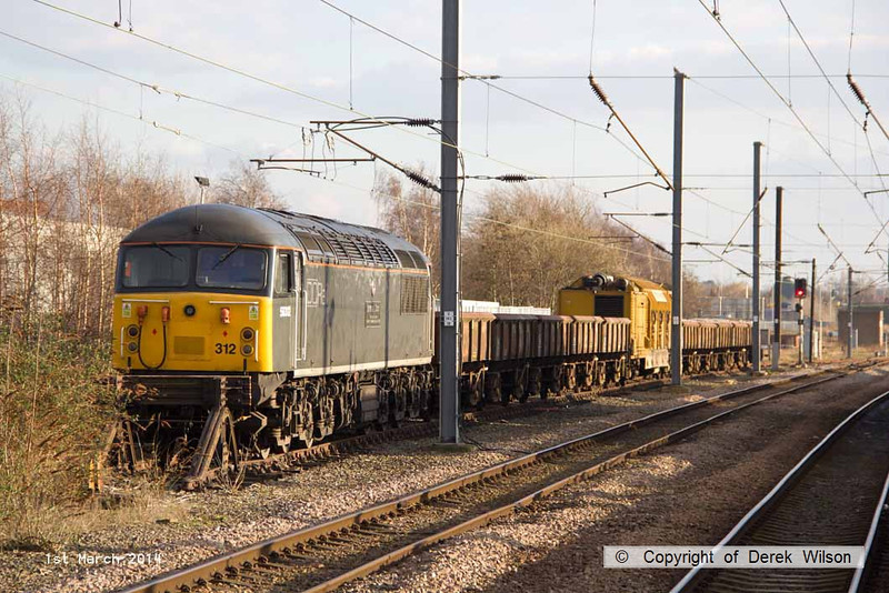 140301-034     DCR class 56 no 56312 Jeremiah Dixon is seen at Newark North Gate, with a rake of PNA wagons, and the Railvac sandwiched between them.