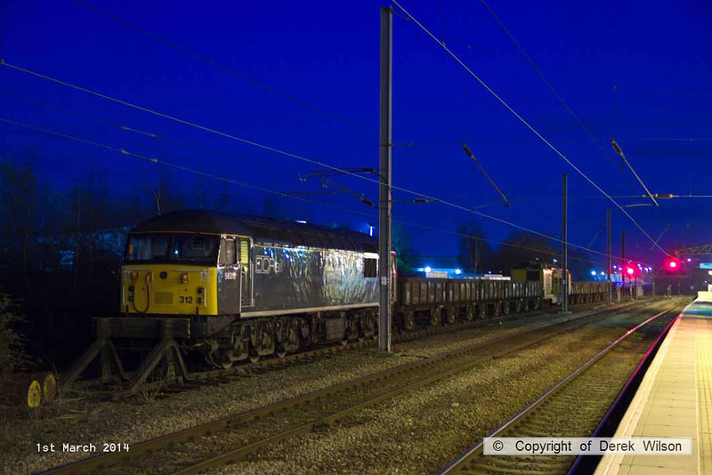 140301-047     DCR class 56 no 56312 Jeremiah Dixon illuminated by the station lights at Newark North Gate.