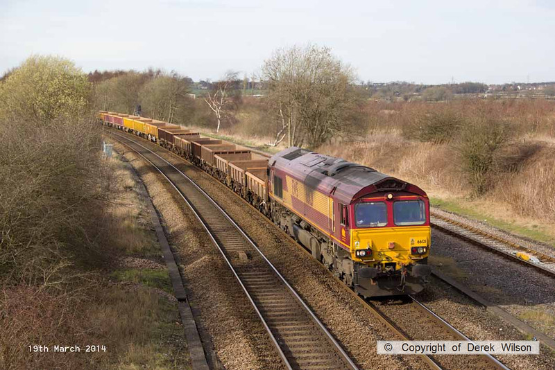 140319-032      DB Schenker class 66/0 no 66121 is seen passing Stonebroom, powering 6M23, the 12.57 Doncaster up decoy to Mountsorrel, hauling a assortment of ballast/spoil wagons.