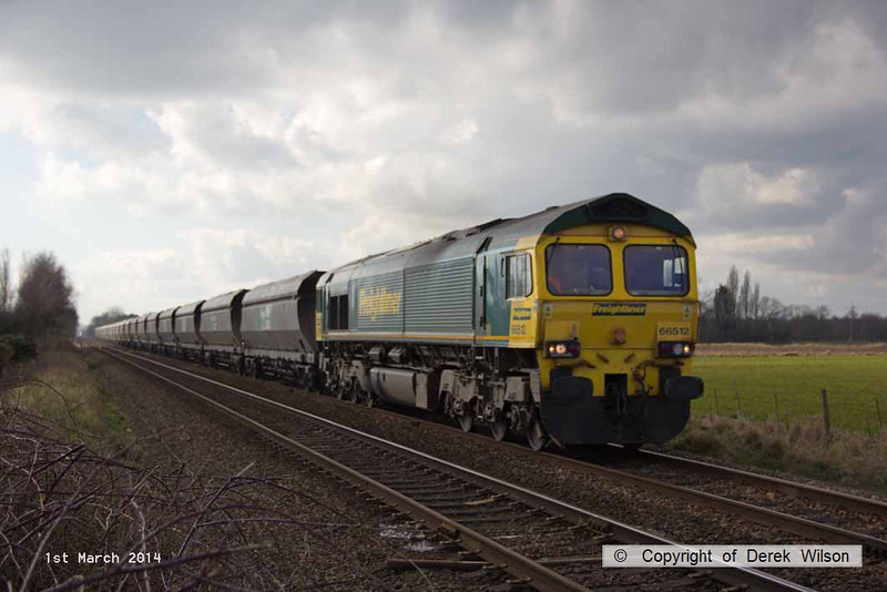 140301-002     Freightliner class 66/5 no 66512 passing Rolleston with 4R16, the 11.43 Ratcliffe power station to Immingham import terminal, empty coal hoppers.