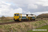 140323-002     Volker Rail track tamper no DR75401 is seen passing Rearsby as 6J38, the 09.59 Doncaster paper sidings to Manton junction.