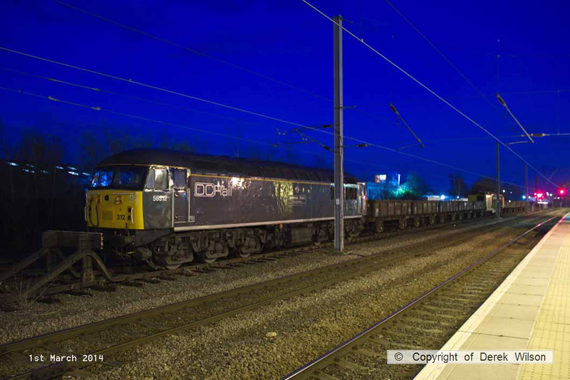 140301-046     DCR class 56 no 56312 Jeremiah Dixon illuminated by the station lights at Newark North Gate.