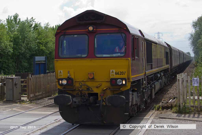 140520-010     DB Schenker class 66/0 no 66207 is captured passing through Thurgaton, powering train 4E04, the 14.17 Ratcliffe power station to Immingham, Humber International Terminal, empty coal hoppers.