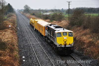 On Tuesday 1st April the Sperry Train visited the Cobh & Midleton Branches before stabling in Mallow for the night. The following day it operated as the 0945 Mallow - Portlaoise. To provide additional brake force two wagons and BR Van 3187 from the Weedspray Train are marshalled into the train as well.   082 is pictured at Clonkeen Bridge shortly before its arrival at Portlaoise. Tues 02.04.14  For pictures of the Sperry Train in East Cork on Tuesday 1st April 2014, click here  for photographs by Finnyus.
