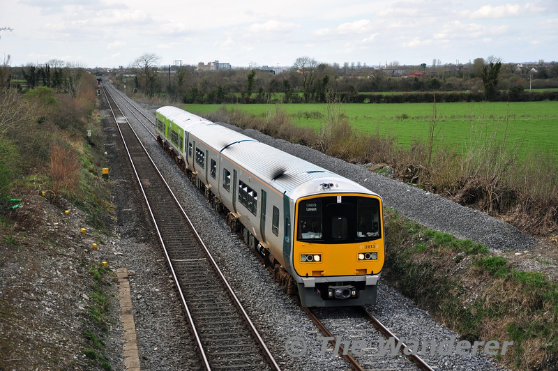 "On April Fools Day another 2700 Class transfer from Limerick to Inchicore operated. After being looped at Portarlington, 2813 + 2814 are pictured at Killenard hauling 2724 + 2715  with the 1200 from Limerick to Inchicore. The 2800 Class then returned to Limerick. Tues 01.04.14 <br><br> For pictures of the other transfers to Cork &amp; Inchicore click on the picture links below: <br><br><a href=""http://www.flickr.com/photos/finnyus/12796023944"" target=""_blank""> 2813 + 2814 hauls 2719 +2722 though Rathpeacon with a stock transfer from Limerick to Cork. </a> <br><br><a href=""https://www.flickr.com/photos/finnyus/12911861493"" target=""_blank""> 2751, seen here at Burnfort, hauled by 2607 + 2608.</a> <br><br><a href=""https://www.flickr.com/photos/finnyus/13272390433"" target=""_blank"">2717 + 2718 at Mourneabbey hauled by 2600 class railcar set, 2614 + 2617, being transferred from Limerick to Cork for storage in Cork Shed. </a> <br><br><a href=""http://thewandererphotos.smugmug.com/2014Photos/March-2014/i-QN8nrdn"" target=""_blank"">2803 + 2804 are pictured at Ratheven hauling stored 2720 + 2721 as the 1100 Limerick - Inchicore. Tues 25.03.14. </a> <br><br><a href=""http://thewandererphotos.smugmug.com/2014Photos/March-2014/i-jdmchCL"" target=""_blank"">The clear out of the stored 2700 Class DMU's from Limerick to Cork &amp; Inchicore continued on Friday 28th March 2014. The 2nd transfer to Inchicore consisted of 2813 + 2814 hauling 2708 + 2707 as the 0750 Limerick - Inchicore. It is pictured passing Portarlington. </a>"