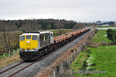 "075 hauls the ""steel train""past Cloney between Athy and Cherryville. The 0955 Belview - Portlaosie Per Way Yard was running 1hr 20minutes late at this stage and had slotted into the 1130 freight path between Waterford and Portarlington. Sat 22.02.14"