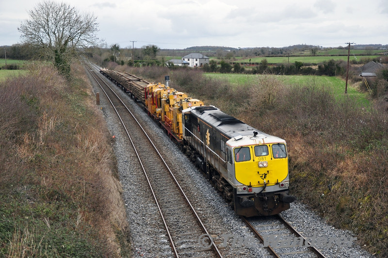 During the weekend of 22nd/23rd of February there was track relaying on the Navan Branch. The following Monday, 081 brought the relaying train back to Portlaoise Per Way Depot as the 1045 ex Platin. It is pictured at Ratheven, Portlaoise running about 60 minutes early after its booked stop at Sallins Loop was omitted. Note the relaying gantries 772 & 776 which are loaded onto two flat wagons behind the locomotive. Mon 24.02.14