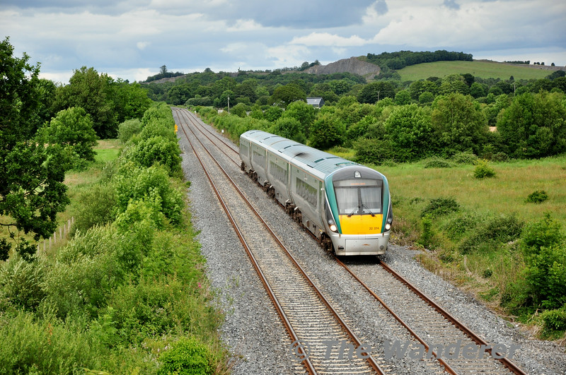 With the former C.I.E. owned Quarry at Lisduff visible in the distance, 22024 passes Killavinoge with the 1525 Heuston - Limerick. Sun 13.07.14