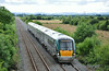 22033 passes Ballysorrell Big, north of Templemore with the 1340 Tralee - Heuston. Sun 13.07.14