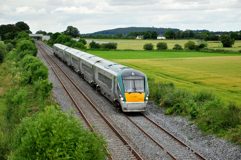 Hot on the heels of the 1700 Cork was 22023 + 22052 working the 1710 Heuston - Laois Depot. Pictured passing Carn Bridge. Sun 13.07.14