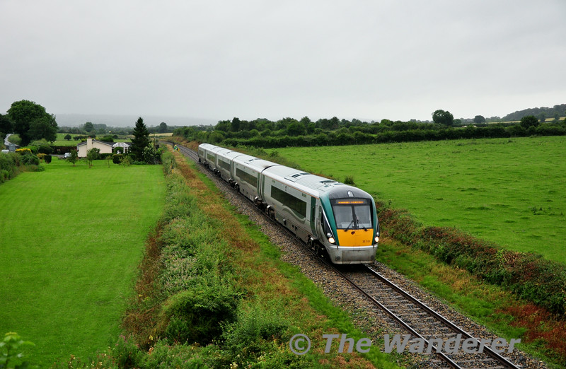 22031 climbs away from Thomastown and is pictured at OBKW81 Killarney Bridge with the 0750 Waterford - Heuston. Fri 18.07.14