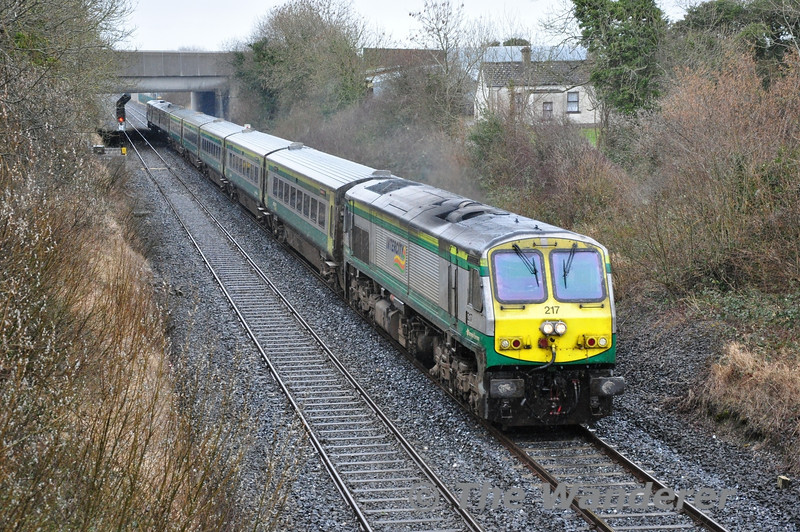 217 powers away from Portlaoise and past Clonkeen Bridge with the 1300 Heuston - Cork. The service was running 35 minutes late due to a fault with the 1215 Heuston - Portlaoise at the Curragh. Fri 21.03.14