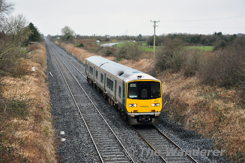 With expected heavy loadings on the 1220 Cork - Heuston on Friday 21st March 2014 it was decided to extend the 1245 Limerick - Limerick Jct. to Heuston to sweep the road ahead of it. Expecting 3ICR to be allocated to it I was surprised when 2803 + 2804 thundered past Clonkeen on the way to Heuston running about 12 minutes late. Fri 21.03.14