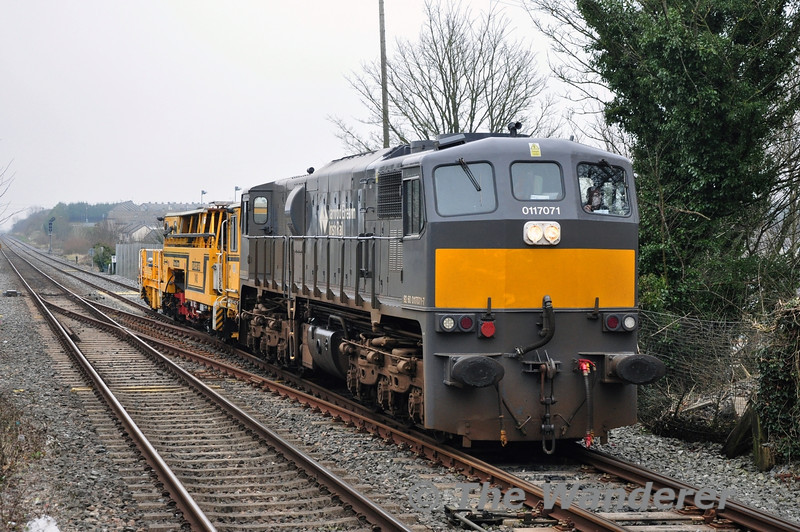 Tamper 740 required to be hauled from Kildare to Portlaoise on Thurs 13.03.14. 071 went Light Engine from Portlaoise to collect the Tamper and haul it back at 1030 from Kildare. The movement is pictured arriving into Portlaoise Station.
