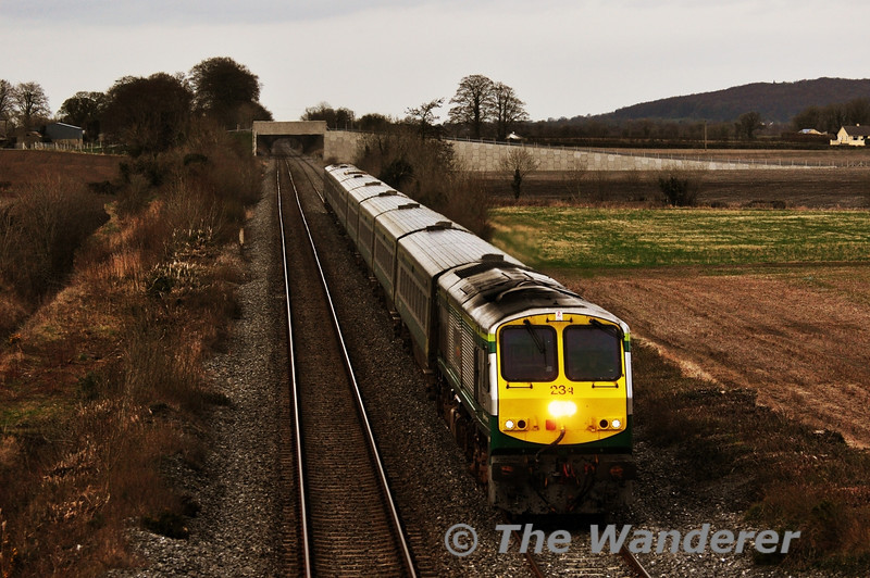 234 passes Carn Bridge with the 1700 Heuston - Cork. Wed 19.03.14