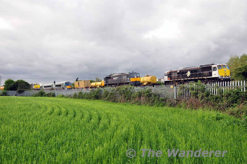 A busy scene at Portarlington. 22021 heads out of the Down Loop heading for Athlone, 078 passes through the Station with the delayed 1140 Ballina - North Wall IWT Liner. 078 took over the train at Geashill. In the sidings is 086 on the Weedspray Train and 082 on the Autoballasters. Wed 07.05.14