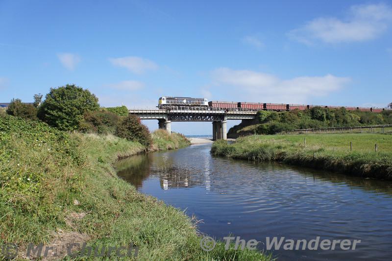 083 crosses Gormanston Viaduct hauling the empty 1400 Alexandra Road - Tara Mines. Wed 10.09.14<br /> <br /> Photo courtesy of Mr. Church.