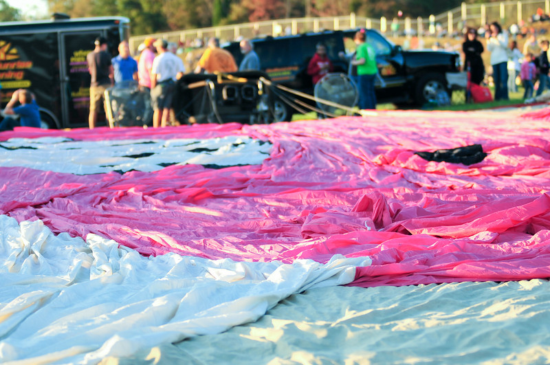 hot air balloon ready for assembly on a field