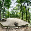 Heavily wooded camp site ready for campers