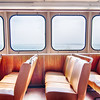 ferry boat cabin and rows of seats looking out the window