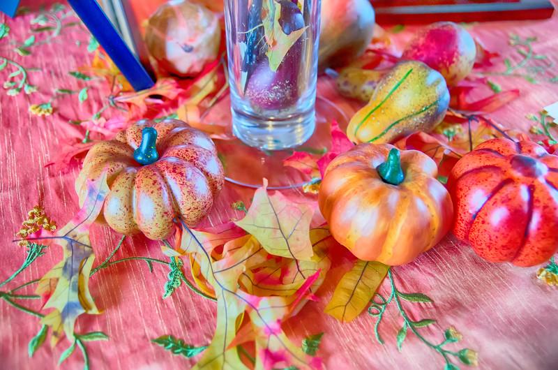 autumn harvest with pumpkins on table
