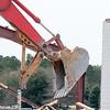wreck excavator at work demolishing a building wall