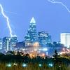 thunderstorm lightning strikes over charlotte city skyline in north carolina usa