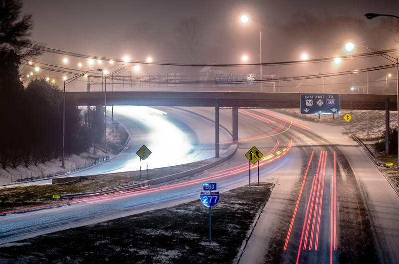 traffic on icy highway at night