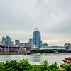 Cincinnati skyline and historic John A. Roebling suspension bridge cross Ohio River.