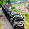 slow moving Coal wagons on railway tracks
