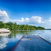 boats at dock on a lake with blue sky