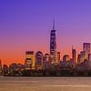 New York City Manhattan midtown panorama at dusk with skyscrapers illuminated over hudson