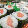 sushi with salmon and avocado rolls