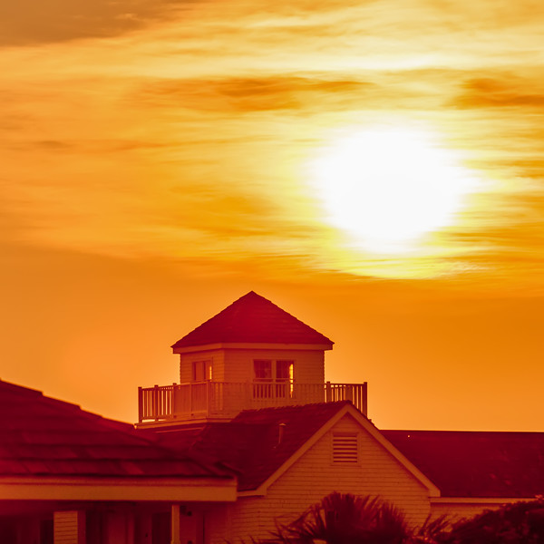 buildings silhouettes at sunrise on cape hatteras natinal seashore