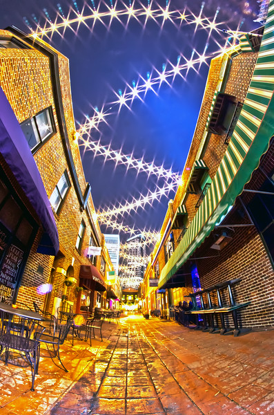 charlotte, nc - january 1st, 2014: Night view of a narrow alley street with restaurants in charlotte, nc