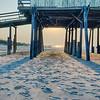 looking under pier towards sandy beach at avon north carolina