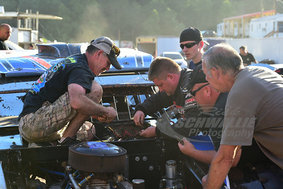 Michael Paul Howard and crew make repairs to his car