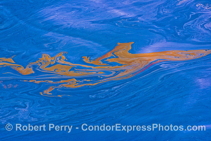 High contrast abstract color patterns on the ocean surface.