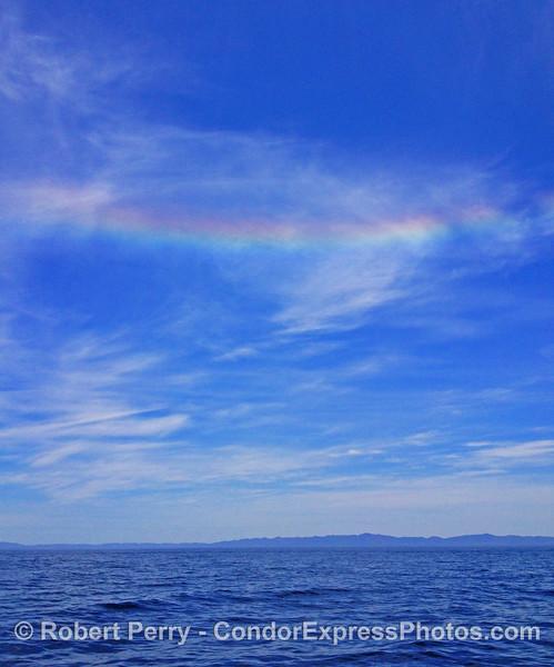 Rainbow in the wispy high cloud layer