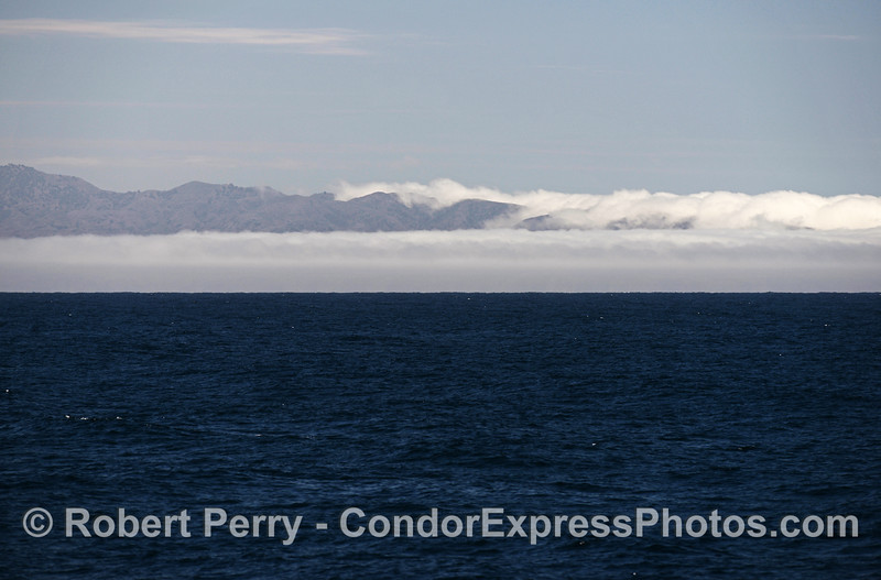 Wind generated clouds and fog shroud the west end of Sta Cruz Island