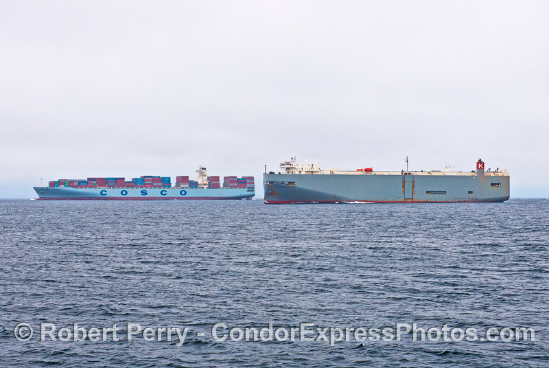 Two northbound commercial cargo ships are photographed as the car carrier Western Highway (right) begins to overtake and pass the container vessel Cosco Europe (left) in the Santa Barbara Channel