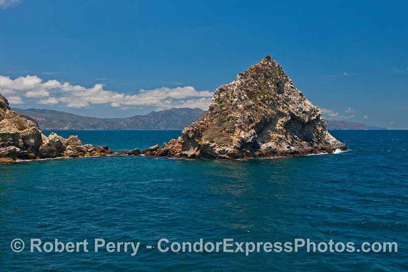 A rocky outcrop marks the entrance to Potato Harbor looking west along the north face of Santa Cruz Island towards Prisoner's Harbor