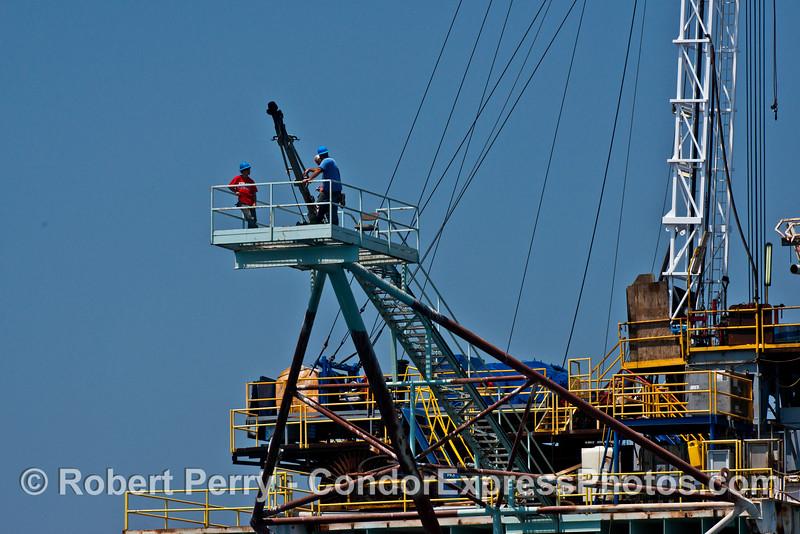 Workers up on platform Hogan