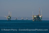 Offshore oil platforms.  Platform Houchin is on the right, Henry on the left.  Hillhouse, C, B and A are inthe distance.