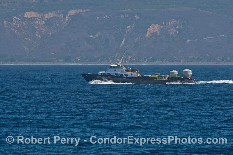 Oil platform support boat, Jackie C - at work hauling equipment