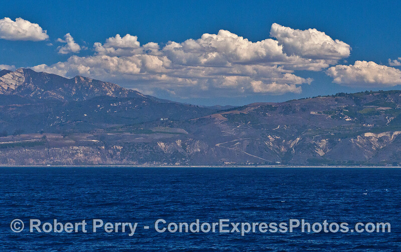 Western Ventura coastline, Santa Ynez mountains, and high humidity cloud layer
