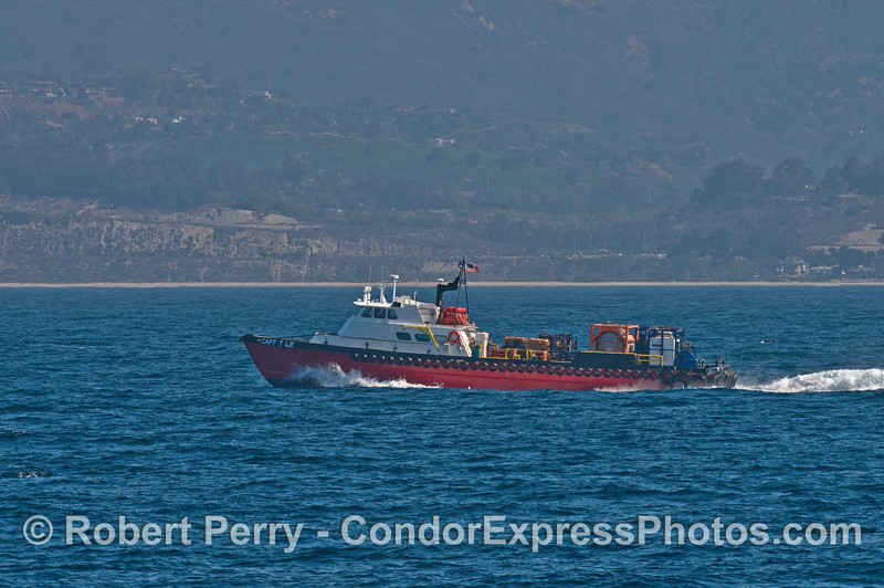 """Capt T Lee"" oil platform support vessel is seen carrying a load back to shore"