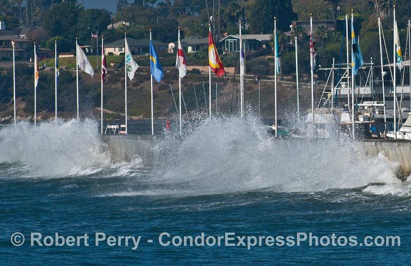 A wave crashes against the sea wall - Santa Barbara Harbor.