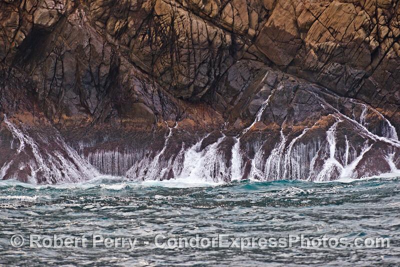 Rivers of water run off the intertidal zone on the sea cliffs of Santa Cruz Island