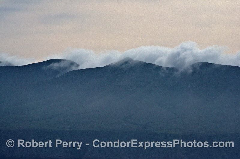 Clouds spill over the moutain peaks on Santa Cruz Island